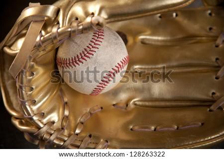golden glove with baseball/golden glove - stock photo