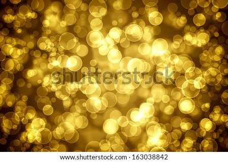 Golden glowing bokeh holiday background - stock photo