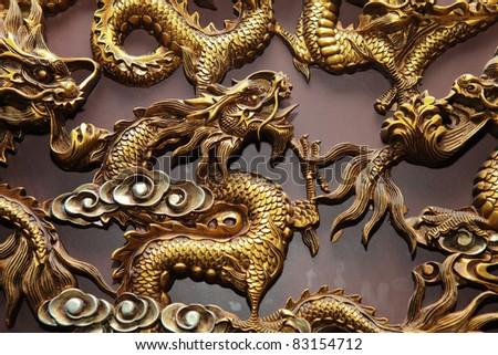 Golden gragon statue - stock photo