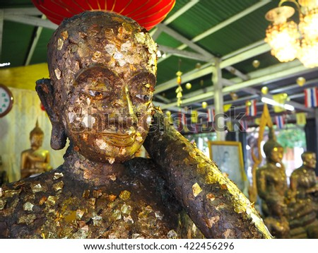Golden head of meditating Buddha inside Thai temple - stock photo
