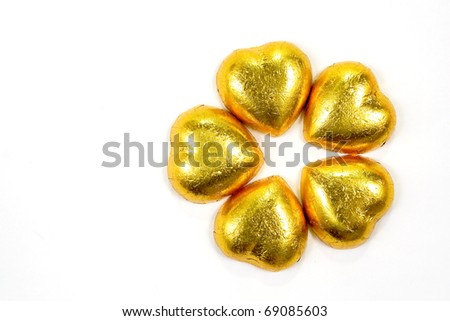 Golden heart shape chocolate for Valentine's Day - stock photo