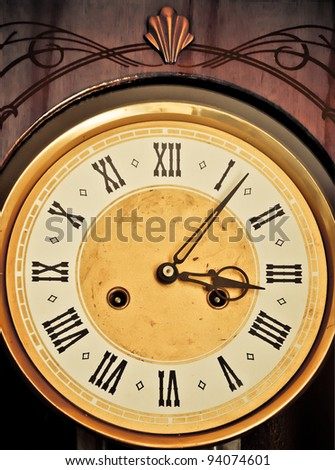 Golden historic clockface with Roman hours - stock photo
