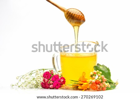 golden honey and colorful flowers - stock photo