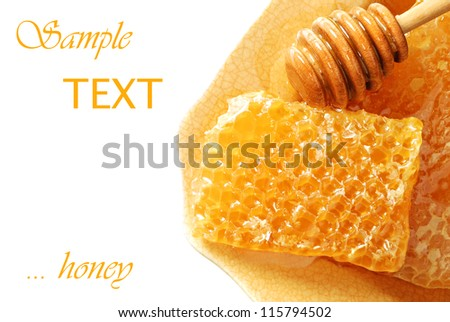 Golden honeycombs with honey and drizzler on plate with white background and copy space. - stock photo