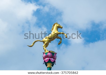 Golden horse statue to decorate at wayside in Thailand. - stock photo