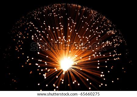 Golden illuminated fibre optic lamp. - stock photo