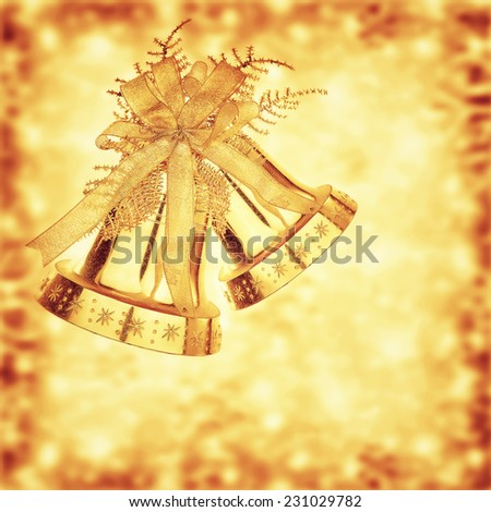 Golden jingle bells, Christmas tree ornament and holiday decoration on blurry background, beautiful greeting card for wintertime holidays - stock photo