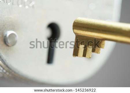 Golden key and padlock close-up selective focus - stock photo
