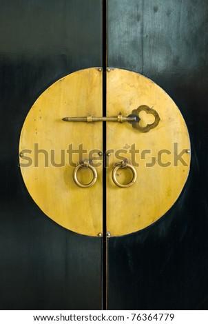 golden key in the door of old cabinet wood - stock photo