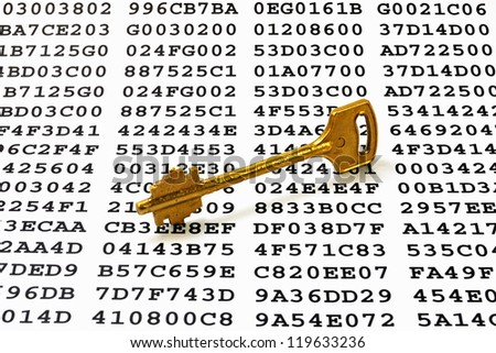 Golden key on a sheet with encrypted data - stock photo