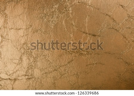 Golden leather background close-up - stock photo
