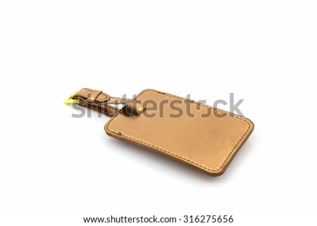 Golden leather luggage tag on white background.  - stock photo