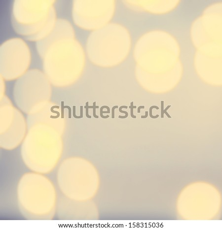 Golden Lights Festive Christmas  background with texture. Abstract Christmas twinkled bright background with bokeh defocused  lights