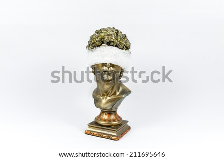Golden Male Statuettes with white gauze - stock photo