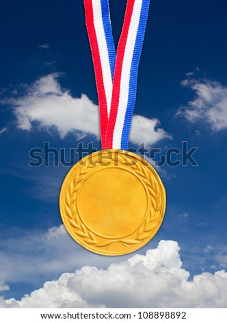 Golden  medal in front of blue sky. - stock photo