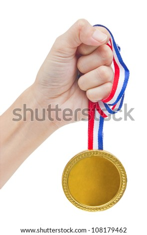 Golden medal in woman's hand isolated on white background. - stock photo