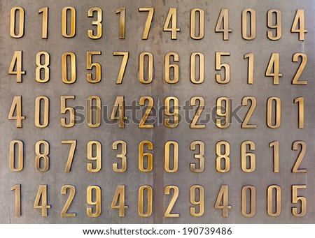 golden metallic digits on a metal background - stock photo