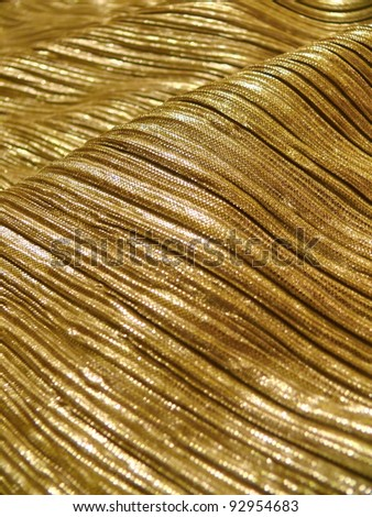 Golden, metallic, shining scarf or dress for disco, party or fashion design. More of this motif & more textiles in my port. - stock photo