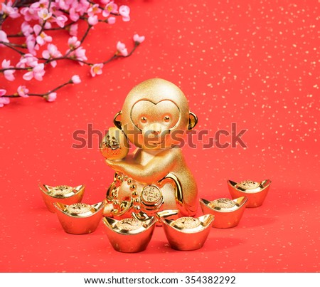 golden monkey with decoration - stock photo