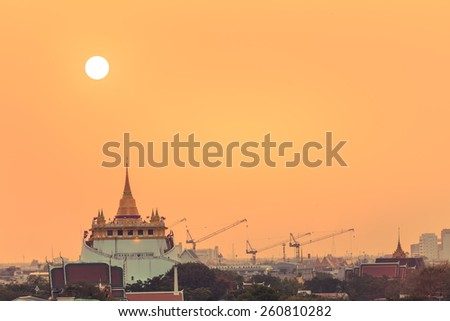 Golden Mount Temple Fair, Golden Mount Temple with red cloth in Bangkok at sunset (Wat Sraket, Thailand) - stock photo