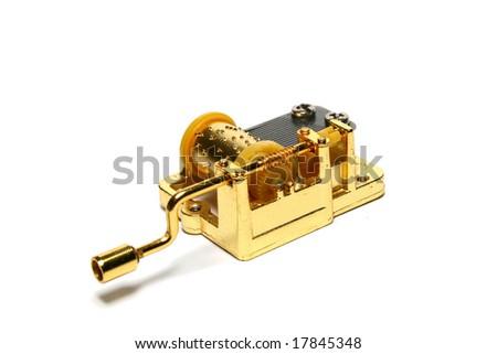 Golden music box on white background - stock photo