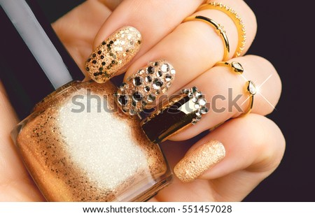 Golden Nail Art Manicure Holiday Style Bright With Gems And Sparkles Bottle Of