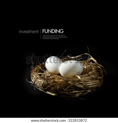 Golden nest with speckled white eggs against a black background. Concept image for pension funding, investment and growth. Generous accommodation for copy space. - stock photo