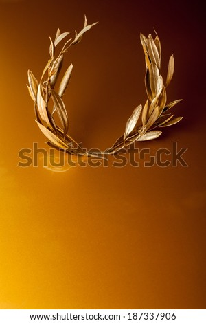 Golden Olive Wreath on golden background - stock photo