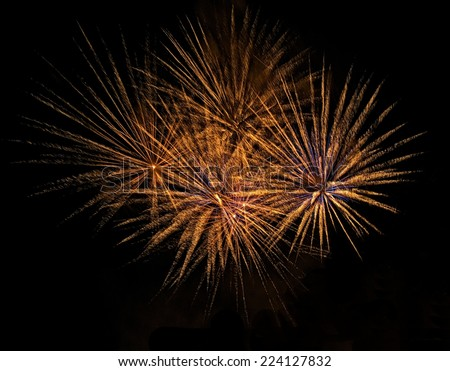 Golden orange fireworks isolated in dark background