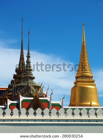 Golden pagoda and Temple of Emerald Buddha Wat Phra Kaew at Grand Palace in Bangkok Thailand. - stock photo