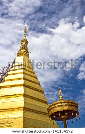 Golden Pagoda at Wat Phra That Cho Hae , Phrae Province, Thailand - stock photo