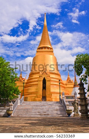 Golden pagoda in temple of emerald Buddha of Royal Grand palace in Bangkok, Thailand - stock photo
