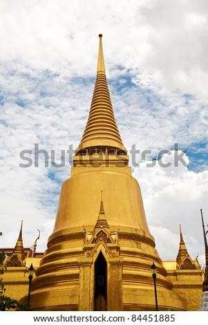 Golden pagoda in Wat Phra Kaeo (Temple of Emerald Buddha), Thailand - stock photo