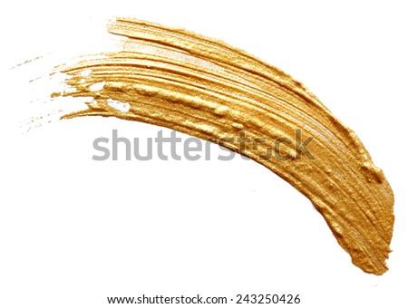 Golden paint isolated on white background - stock photo