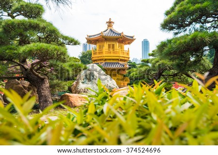 Golden Pavilion of Perfection green leaf foreground in Nan Lian Garden