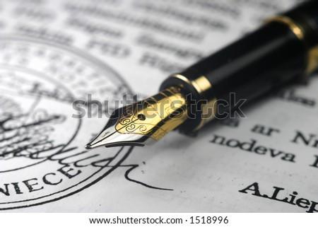 Golden pen - stock photo