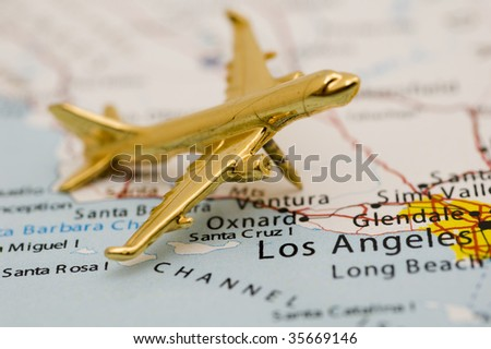 Golden Plane Over Los Angeles. Map is Copyright and Trademark Free, Downloaded off www.nationalatlas.gov - stock photo