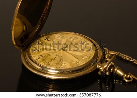Golden pocket watch - stock photo
