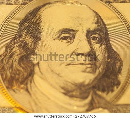 Golden Portrait of Benjamin Franklin on a one hundred dollar banknote - stock photo