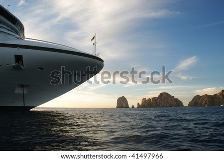 Golden Princess Cruise Ship and Land's End, Just before leaving at Sunset from Cabo San Lucas, Mexico - stock photo