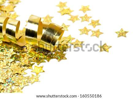 golden ribbon and confetti stars - stock photo