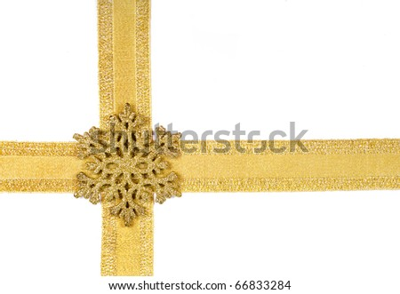 Golden ribbon with snowflake isolated on white - stock photo