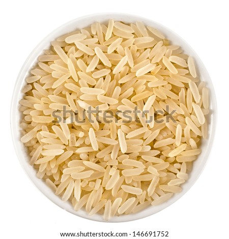 golden rice heap in bowl top view surface close up isolated on white background  - stock photo