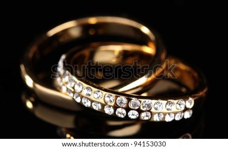 Golden ring on black - stock photo
