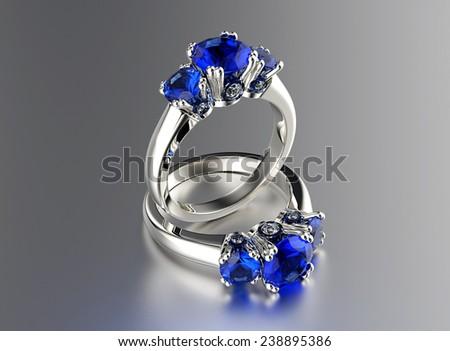 Golden  Ring with Diamond. Jewelry background. Sapphire gemstone - stock photo