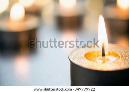 Golden Romantic Tea Lights In Bright Xmas Atmosphere On Wooden Table With Bokeh - stock photo