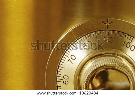 Golden safe lock, in close-up. - stock photo