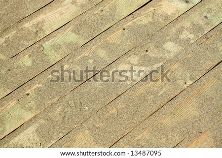 golden sands on the wooden floor - stock photo