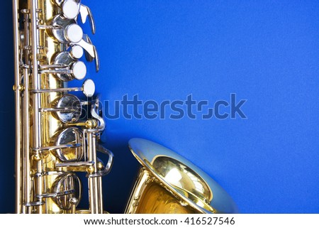 Golden saxophone. space for text. concept for information, announcements, Festival, a musical event - stock photo
