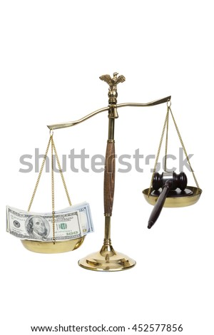 Golden scales of justice, gavel and money on a white background - stock photo